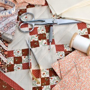 Nine patch block and tools for quilting.