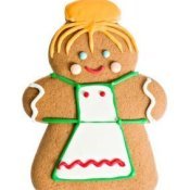 Gingerbread woman cookie, with apron and hair bun.