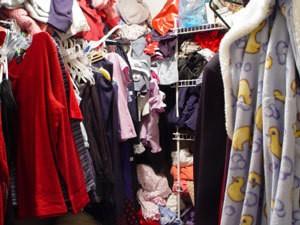 Photo of a messy closet.