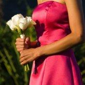 A woman wearing a homemade bridesmaid dress.
