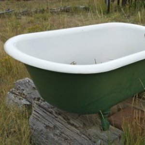 Restoring a Claw Foot Tub, An old claw foot tub outside.