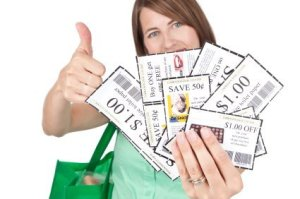Woman Holding Handful of Coupons with Thumbs Up