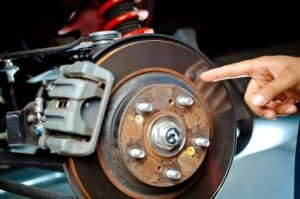 Man Pointing at Brake Rotor