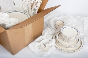 Dishes Being Packed into Box