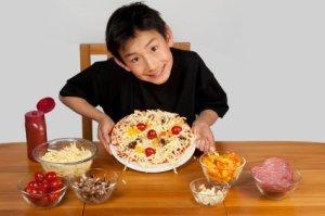 Homemade Pizza Recipes, Boy Holding Homemade Pizza