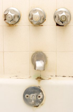 Dirty Bathtub and Fixtures