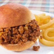 Sloppy Joe Recipes, Sloppy joe on a plate with curly fries.