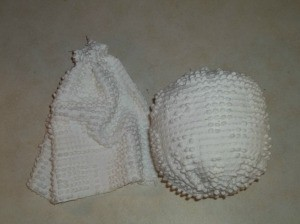 Closed chenille tube to form head and stuffed head.