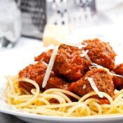 A plate of spaghetti with meatballs.