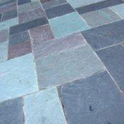 Cleaning Tile Floors, Textured blue floor tile.