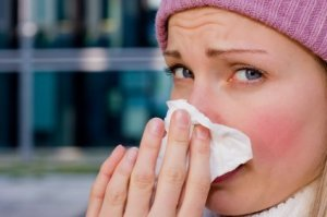 Preventing Colds and Flu, Woman with a Cold Blowing Her Nose