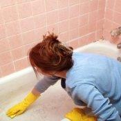 Woman Cleaning Bathtub