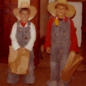 Two boys dressed up as cowboys for Halloween.