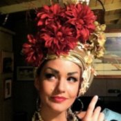 A close up of the Carmen Miranda costume, with a fancy flowered hat.