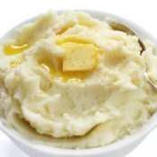 Mashed potatoes with melting butter on top.
