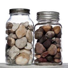 Rocks inside two mason jars.
