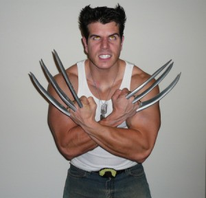 A homemade Wolverine (X-Men) costume with yellow eyes and long metal claws.