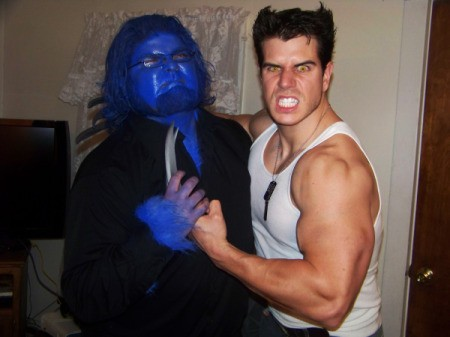 A X-Men Wolverine costume posing with a blue Beast costume.