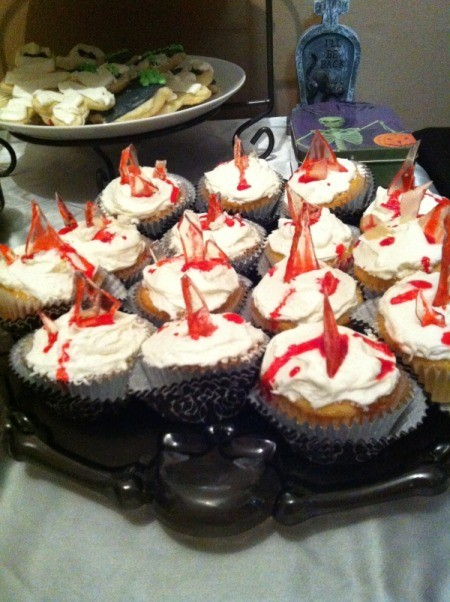 Cupcakes with bloody glass shards as decoration, for a Halloween party.
