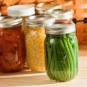 Canned green beans with other vegetables in background.