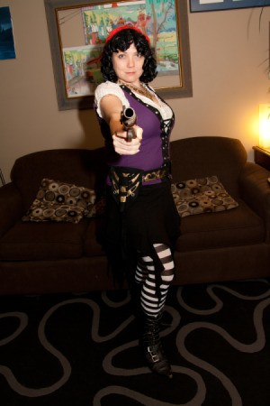 Girl Pirate with Gun Pointing at Camera