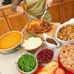 A woman preparing a Thanksgiving meal.