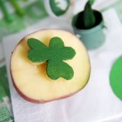 Making a Potato Stamp, Shamrock potato stamp with green paint.