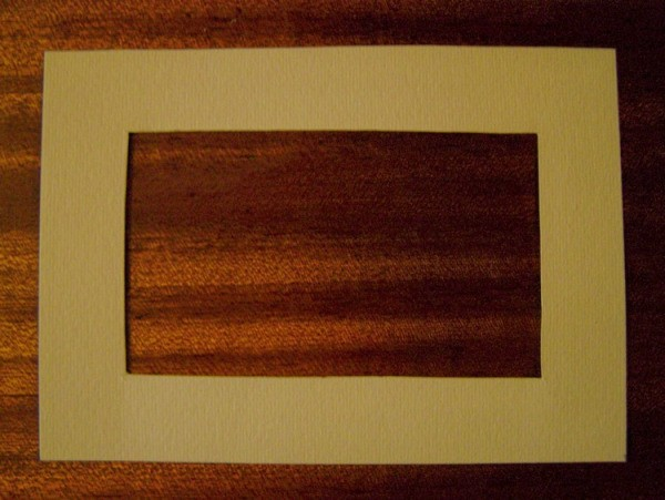 cream-colored cardboard to make a frame