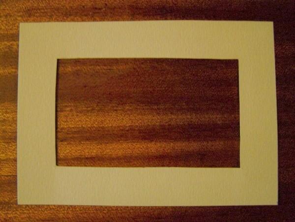 cream-colored cardboard to make a frame