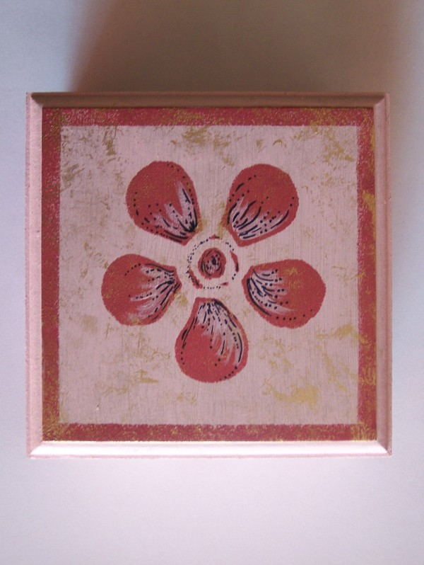 Pink flower painted on top of small pink box