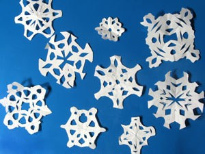 Photo of paper snowflakes.