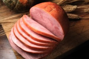 Large Baked Ham Sliced on Cutting Board