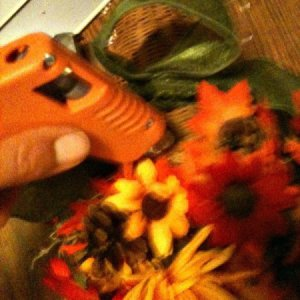 Flowers being glued to Cornucopia