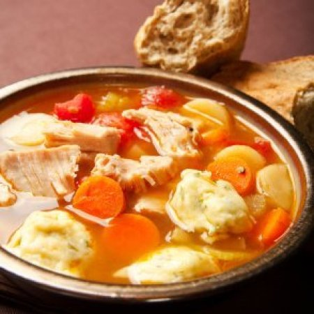 Turkey dumpling soup with carrots.