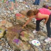 Girl Painting Rocks on the Beach