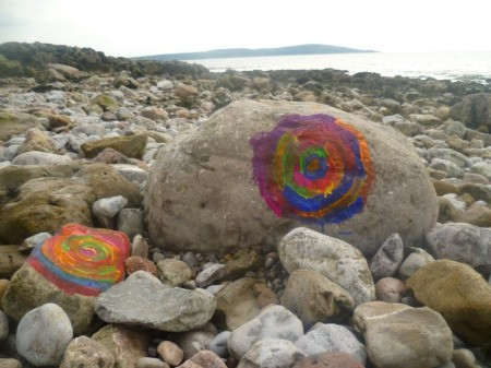 Colorful Spiral Painted on Large Rock on the Beach