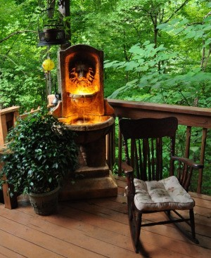 Garden Deck with Lighted Lion Fountain in Corner