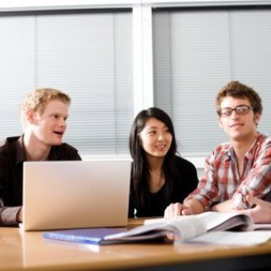 Money Saving Tips for College Students, Students studying at a table.