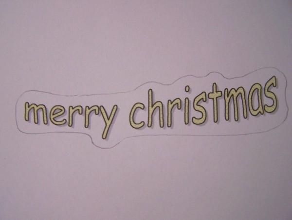 Sheet of paper with Merry Christmas printed on it