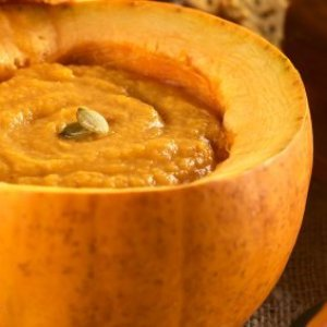 Pumpkin soup inside a pumpkin.