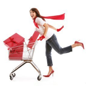A woman pushing a cart of presents.