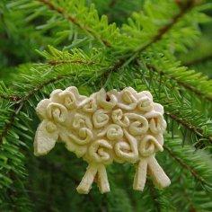 A salt dough ornament on a Christmas tree.