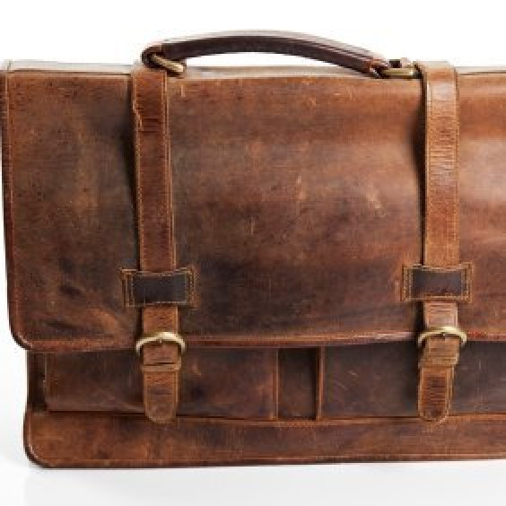 Uses for Old Briefcases, Worn two strap leather briefcase.