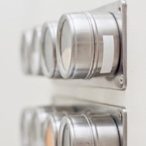 Spice rack with magnetic canisters.