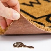 Hiding Keys, A key hidden under a mat.