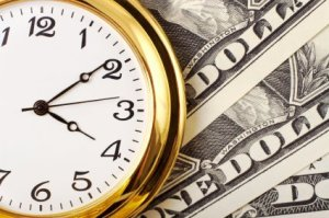 Saving Money vs. Saving Time, Watch Sitting on Top of Dollar Bills