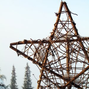 A twig star outside in the snow. Outdoor Christmas decorations can be quite ...