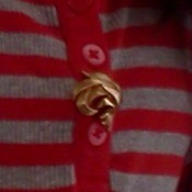 An earring as a decoration on a sweater