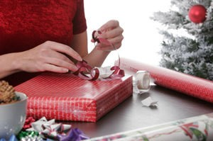 photo of someone wrapping a present