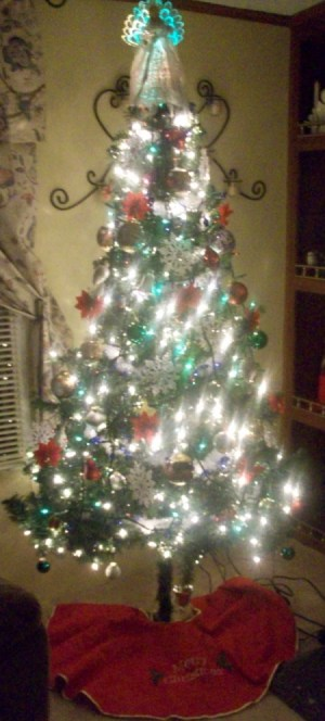 Prelit clear tree with red skirt